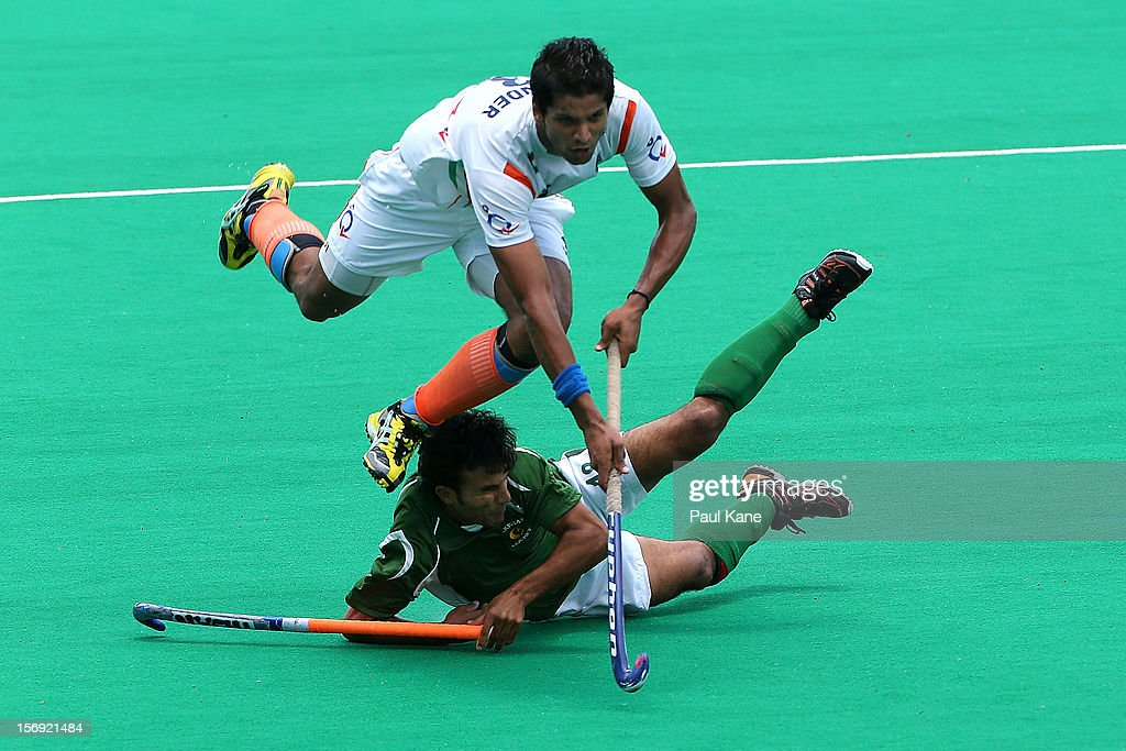 Rupinder Pal Singh of India gets tackled by Muhammad Kashif Ali of Pakistan in the mens bronze medal play off between India and Pakistan during day four of the 2012 International Super Series at Perth Hockey Stadium on November 25, 2012 in Perth, Australia.
