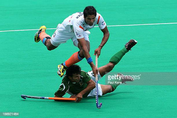 Rupinder Pal Singh of India gets tackled by Muhammad Kashif Ali of Pakistan in the mens bronze medal play off between India and Pakistan during day...