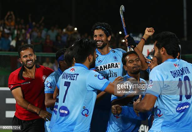 Rupinder Pal Singh of India is congratulated by team mates during the match between Netherlands and India on day ten of The Hero Hockey League World...