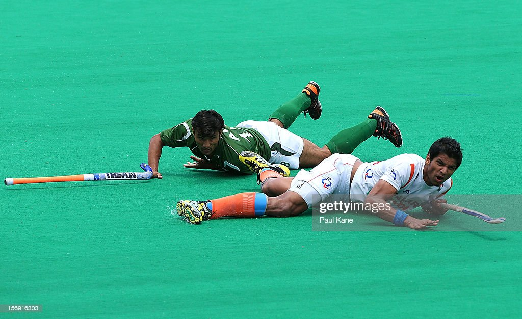 Rupinder Pal Singh of India looks on after being tackled by Muhammad Kashif Ali of Pakistan in the mens bronze medal play off between India and Pakistan during day four of the 2012 International Super Series at Perth Hockey Stadium on November 25, 2012 in Perth, Australia.