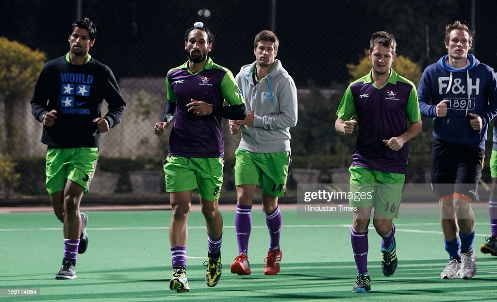 Rupinder Pal Singh (L), Sardar (2nd L), Matt Ghodes (2nd R) during practice session of Delhi Wave Riders hockey team for the upcoming Hockey India League at Major Dhyan Chand National Stadium on January 9, 2013 in New Delhi, India. Hockey India League is professional league for field hockey competition that will be played from 14 January to 10 February. There are 5 franchise teams consisting of players from India and around the world. The matches will be played on Home and away basis culminating into multi header playoffs.