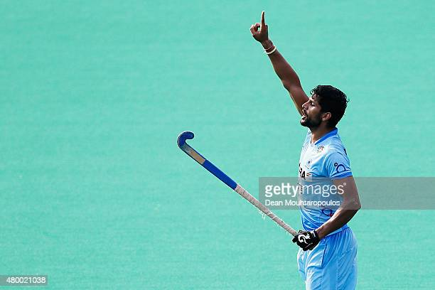 Rupinder Singh of India signals to a team mate during the Fintro Hockey World League SemiFinal match between India and Belgium held at KHC Dragons...