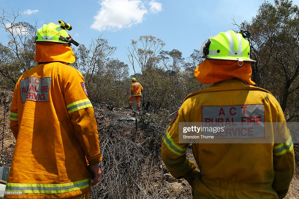 ACT Rural Fire Service members 'mop-up' spot fires at Sandhills on January 9, 2013 in Bungendore, Australia. Temperatures cooled overnight offering relief to fire fighters following yesterday's heat wave recording temperatures of over 40-plus degrees across the state. Crews continue to fight blazes today, taking advantage of the improved conditions ahead fire danger conditions predicted later in the week.