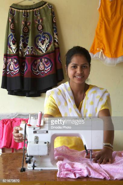 Rural girl on sewing machine socio-economic initiative started by NGO Chinmaya Organization