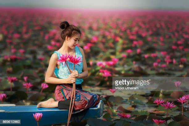 Rural girl sitting on boat