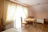 Rural Hostel Room Interior with Wooden Furniture