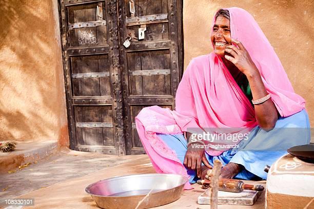 Rural Indian Rajasthani Woman preparing for the food
