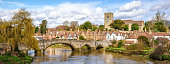 Panoramic view of Aylesford village in Kent, England with medieval bridge and church.