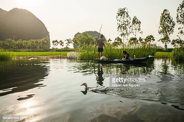 CONTENT] Rural landscape of Ngo Dong river with limestone cliffs in Tam Coc near Ninh Binh city Ninh Binh Province Vietnam
