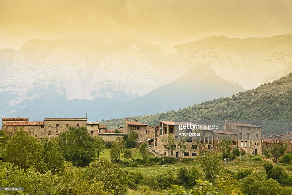 Rural pyrenees town with mountains in background.