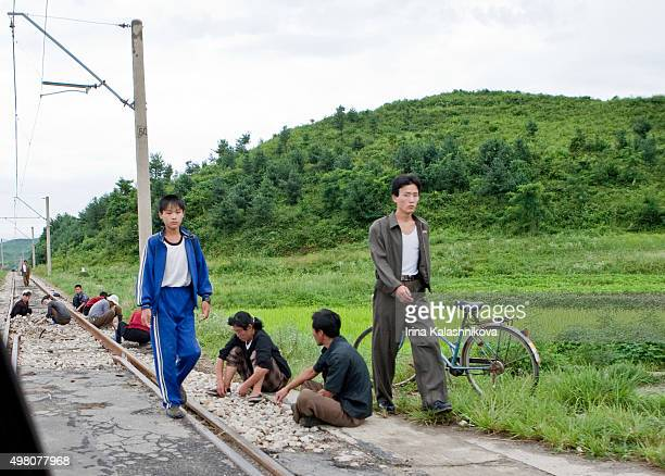 A rural scene in Mount Kumgang area with people repairing railway lines during the '150day Battle' to improve industrial production
