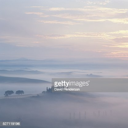 Rural scene with mist at sunrise : Stock Photo