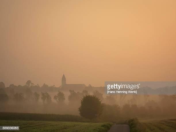 Rural scene with morning fog