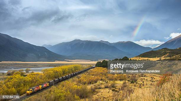 Rural scene with the train and the rainbow