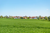 sunny illuminated idyllic rural springtime scenery around a small village  in Hohenlohe, a district in Southern Germany