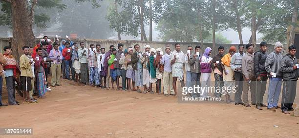 Rural voters standing in queue to cast their vote at a polling booth during the first phase of assembly elections of Chhattisgarh at Jagadalpur on...