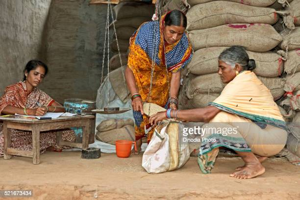 Rural women distributing grains and managing subsides ration shop an economic initiative started by NGO Chinmaya Organization
