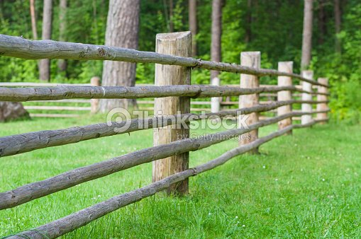 Rural Wooden Fence With Green Lawn Part Of Farm Cattlepen
