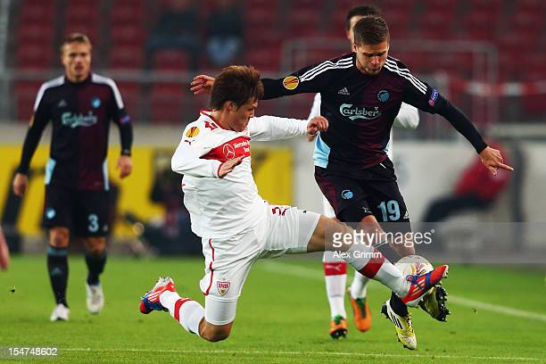 Rurik Gislason of Copenhagen is challenged by Gotoku Sakai of Stuttgart during the UEFA Europa League group E match between VfB Stuttgart and FC...