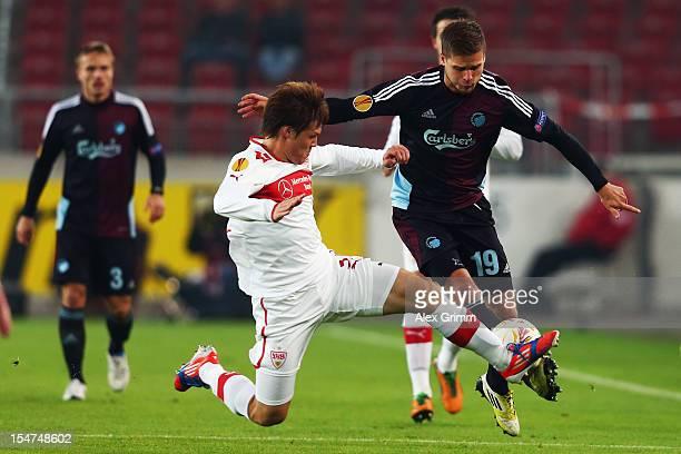 Rurik Gislason of Copenhagen is challenged by Gotoku Sakai of Stuttgart during the UEFA Europa League group E match between VfB Stuttgart and FC...