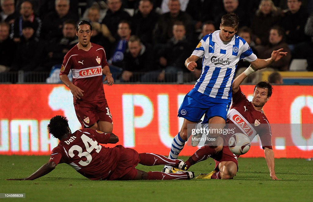 Rurik Gislason of Odense and Stefano Celozzi of Stuttgart compete for the ball during the UEFA Europa League group H match between Odense Boldklub...