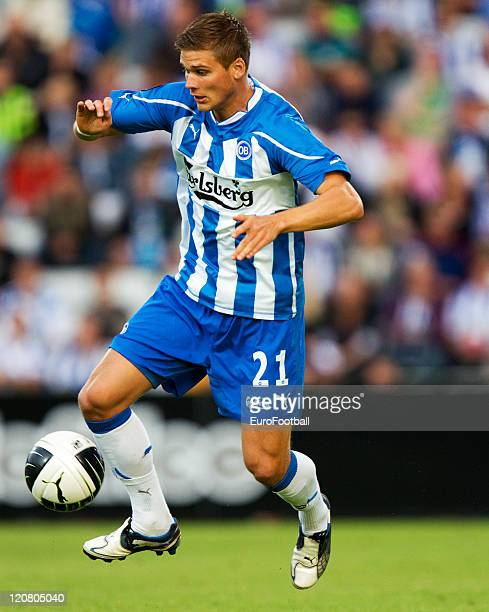 Rurik Gislason of Odense BK in action during the Superliga match between Odense BK and Brondby IF at the TREFOR Park on August 72011 in OdenseDenmark
