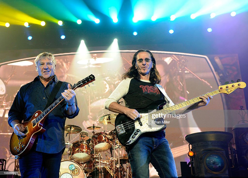 Rush guitarist Alex Lifeson drummer Neil Peart and singer/bassist Geddy Lee perform at the MGM Grand Garden Arena during a stop of the band's Time...