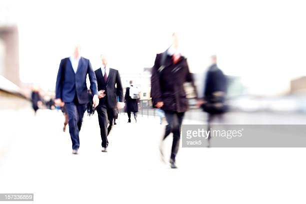 rush hour: abstract high-key business blur of anonymous suited commuters