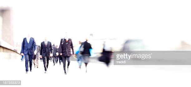 rush hour: high key blurred commuters business abstract