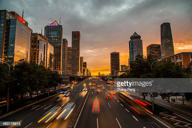 Rush hour in Beijing CBD After a week's sultry and moist days Beijing suddenly welcomes a golden sunset after the rain