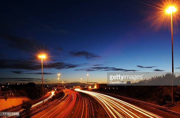 Rush hour on motorway with blurred headlights at dusk