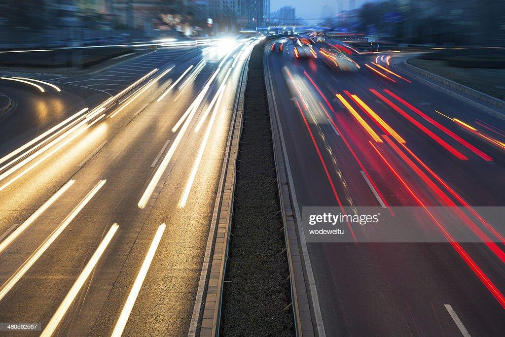 Rush hour traffic at night on multiple lane highway : Stock Photo