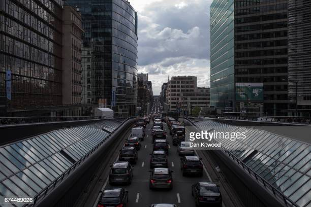 Rush hour traffic slowly makes its way through central Brussels past the European Union Commission headquarters on April 28 2017 in Brussels Belgium...