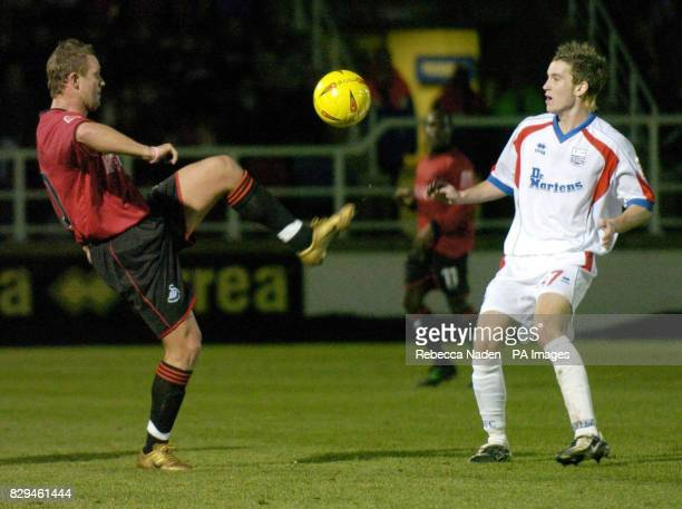 Rushden and Diamond's Luke Kennedy and Swansea City's Lee Trundle in action THIS PICTURE CAN ONLY BE USED WITHIN THE CONTEXT OF AN EDITORIAL FEATURE...