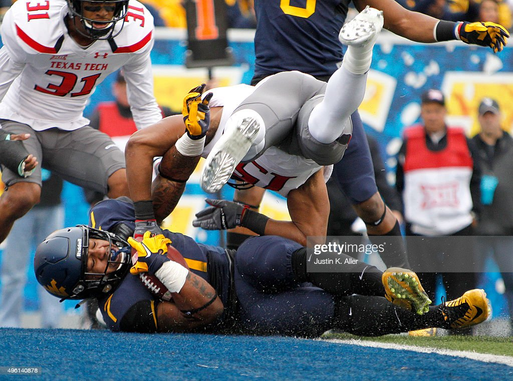 Rushel Shell of the West Virginia Mountaineers rushes for a 5 yard touchdown in the first half during the game against the Texas Tech Red Raiders on...
