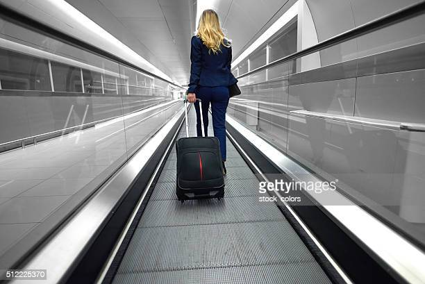rushing business woman on conveyor