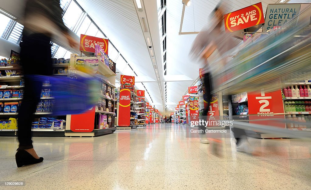 Rushing to bag a bargain - shoppers hit the aisles as new research from Sainsbury's reveals that Britain's bargain hunters spend 64 days, and cover the distance of the equator, in their lifetime traipsing the aisles to bag the best deals with loo roll being one of the most sought after bargains. The research coincides with the national launch of Sainsbury's Brand Match, due to hit UK stores Wednesday, 12th October 2011 on October 10, 2011 in London, England.