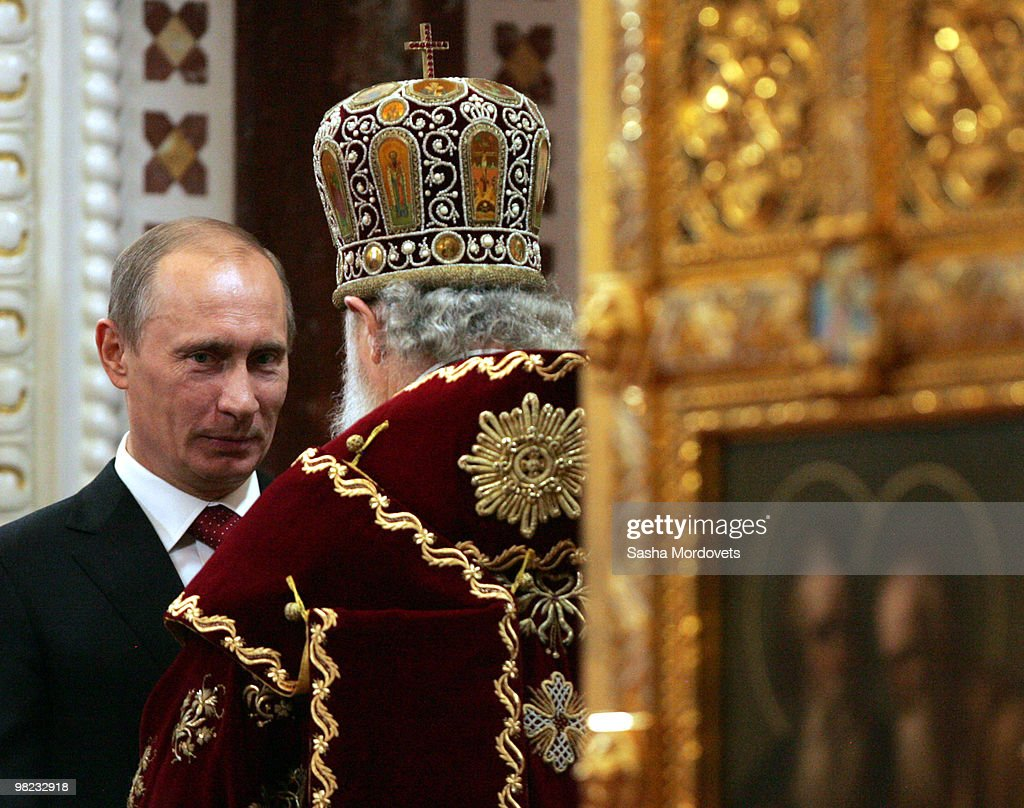 Rusian Prime Minister <a gi-track='captionPersonalityLinkClicked' href=/galleries/search?phrase=Vladimir+Putin&family=editorial&specificpeople=154896 ng-click='$event.stopPropagation()'>Vladimir Putin</a> and Orthodox Patriarch Kirill attend an Easter celebration mess at the Christ The Saviour CathedralApril 4, 2010 in Moscow, Russia. Orthodox Easter and Catholic Easter coincide this year.