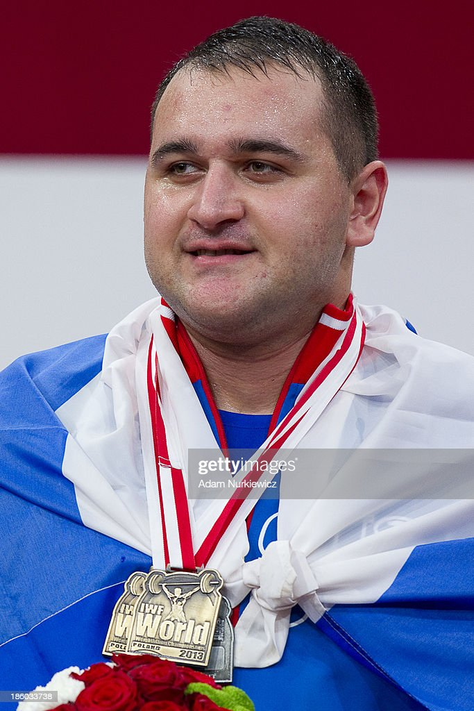 <a gi-track='captionPersonalityLinkClicked' href=/galleries/search?phrase=Ruslan+Albegov&family=editorial&specificpeople=9621994 ng-click='$event.stopPropagation()'>Ruslan Albegov</a> from Russia poses with gold medal in the total competition men's +105 kg Group A during weightlifting IWF World Championships Wroclaw 2013 at Centennial Hall in Wroclaw on October 27, 2013