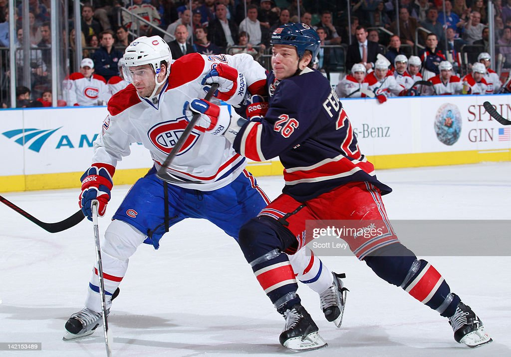 Ruslan Fedotenko of the New York Rangers skates against Frederic StDenis of the Montreal Canadiens at Madison Square Garden on March 30 2012 in New...