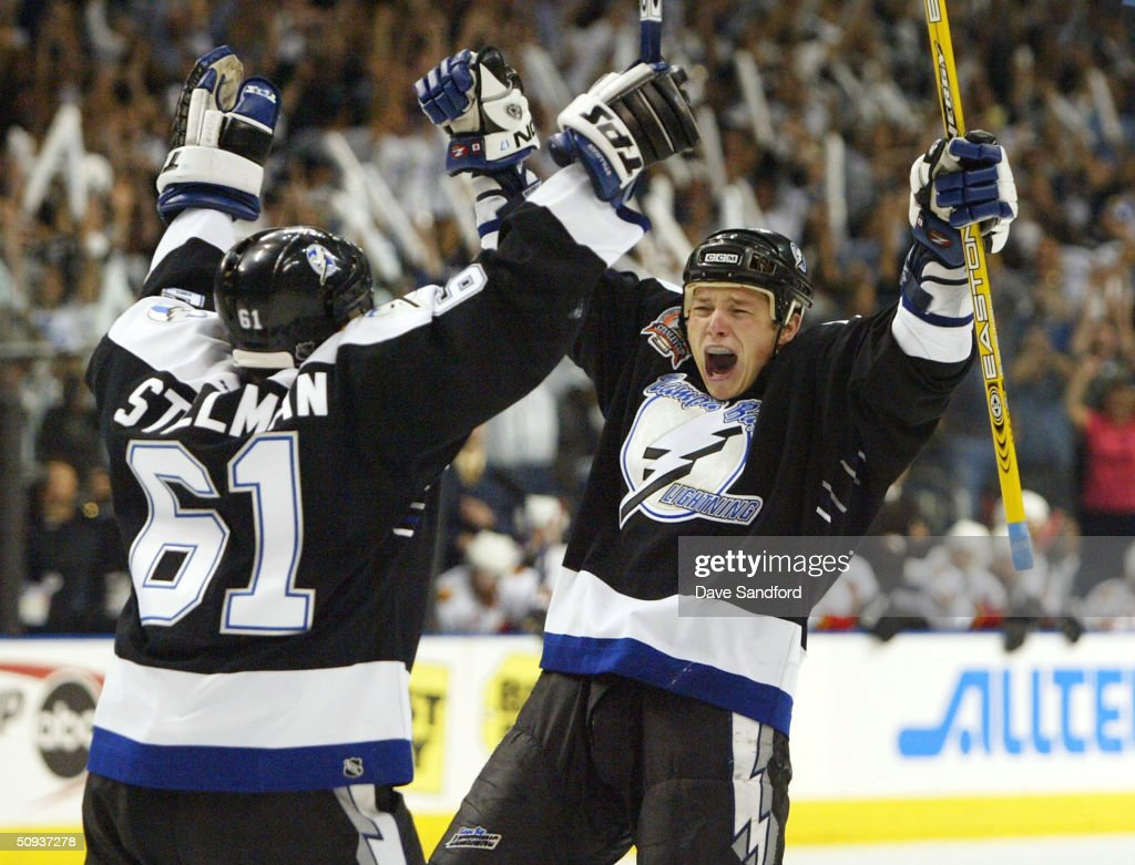 Ruslan Fedotenko #17 of the Tampa Bay Lightning celebrates with teammate Cory Stillman #61 after scoring the team's second goal against the Calgary Flames in game seven of the NHL Stanley Cup Finals on June 7, 2004 at the St. Pete Times Forum in Tampa, Florida.