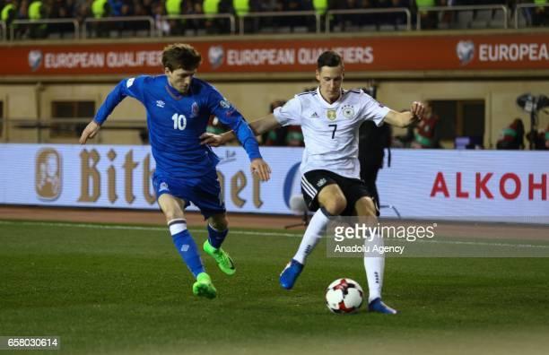 Ruslan Gurbanov of Azerbaijan in action against Julian Draxler of Germany during the 2018 FIFA World Cup European Qualifying match between Azerbaijan...