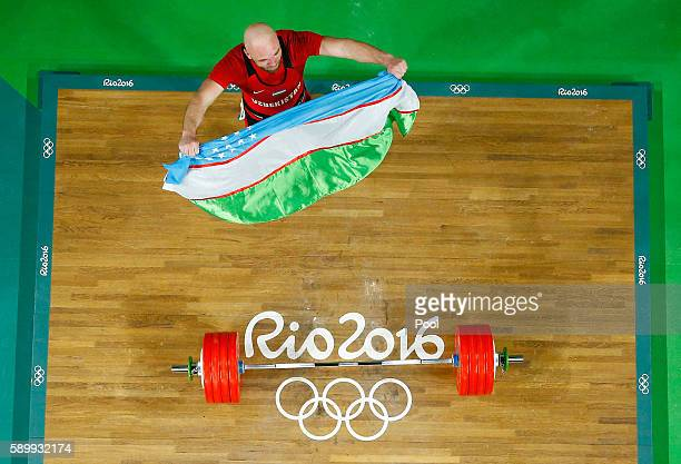 Ruslan Nurudinov of Uzbekistan celebrates after lifting during the Men's 105kg Group A Weightlifting contest on Day 10 of the Rio 2016 Olympic Games...