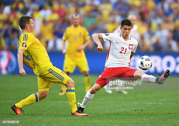 Ruslan Rotan of Ukraine and Bartosz Kapustka of Poland compete for the ball during the UEFA EURO 2016 Group C match between Ukraine and Poland at...