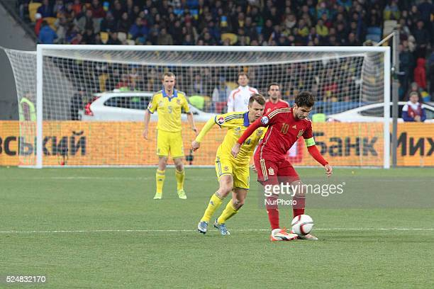 Ruslan Rotan of Ukraine national team vies with Cesc F��bregas of Spain during the European Qualifiers 2016 match between Ukraine and Spain national...