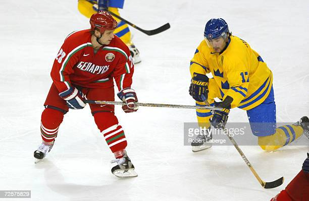 Ruslan Salei of Belarus uses his stick against Mathias Johansson of Sweden during the men's quarterfinals at the Salt Lake City Winter Olympic Games...