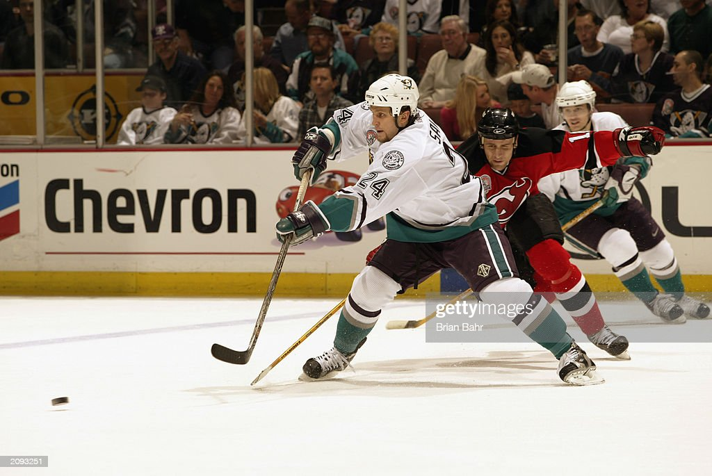Ruslan Salei #24 of the Anaheim Mighty Ducks feeds the puck during Game Six of the 2003 Stanley Cup Finals against the New Jersey Devils at the Arrowhead Pond of Anaheim on June 7, 2003 in Anaheim, California. The Ducks won 5-2.