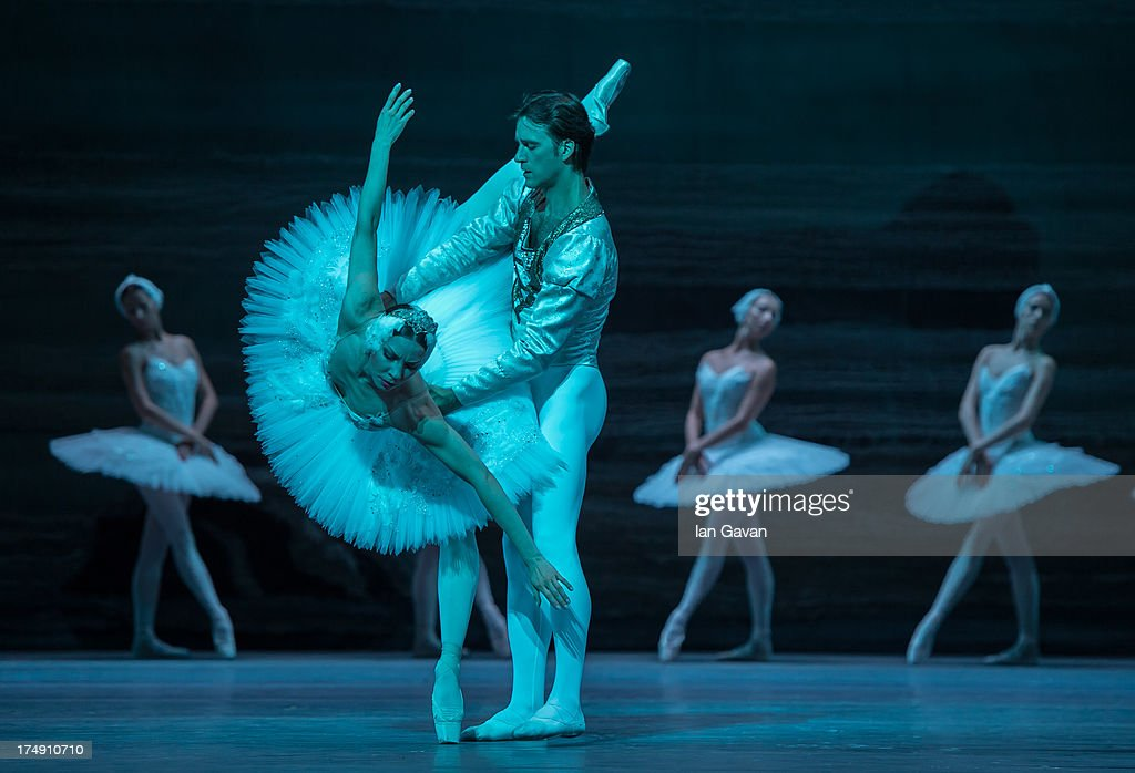 Ruslan Skvortsov and Maria Alexandrova of the Bolshoi Ballet perform during a photocall for 'Swan Lake' at The Royal Opera House on July 29, 2013 in London, England.