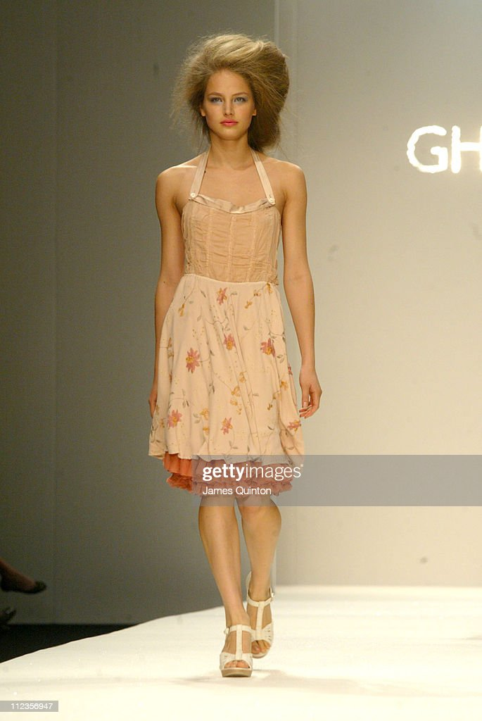 <a gi-track='captionPersonalityLinkClicked' href=/galleries/search?phrase=Ruslana&family=editorial&specificpeople=171840 ng-click='$event.stopPropagation()'>Ruslana</a> Korshunova wearing Ghost Spring/Summer 2006