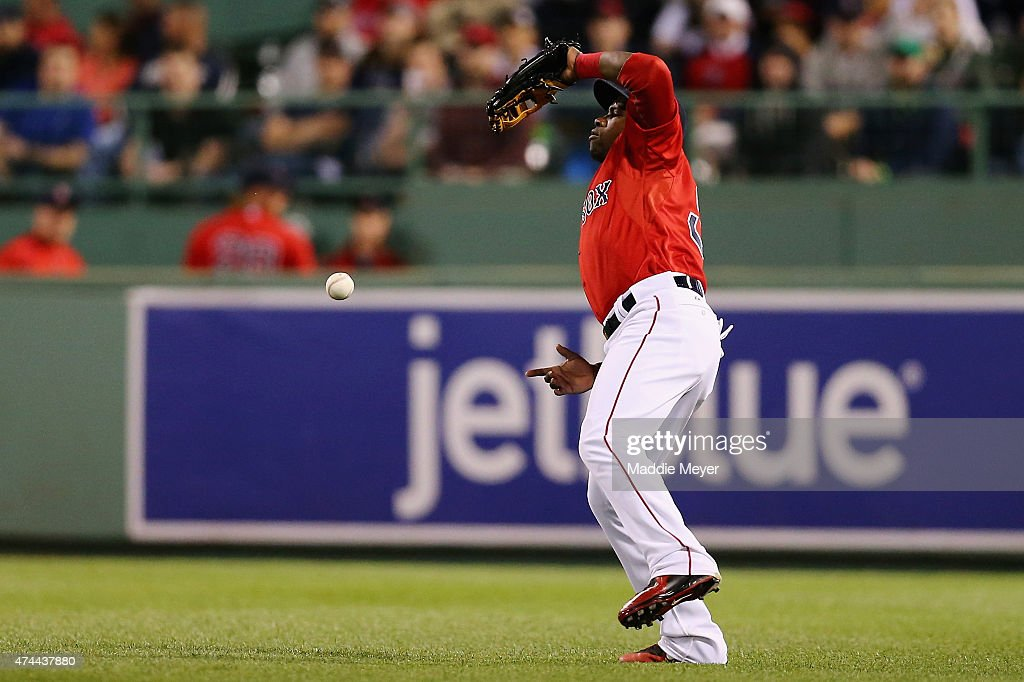 Rusney Castillo #38 of the Boston Red Sox commits an error trying to catch a fly ball during the fifth inning against the Los Angeles Angels of Anaheim at Fenway Park on May 22, 2015 in Boston, Massachusetts.